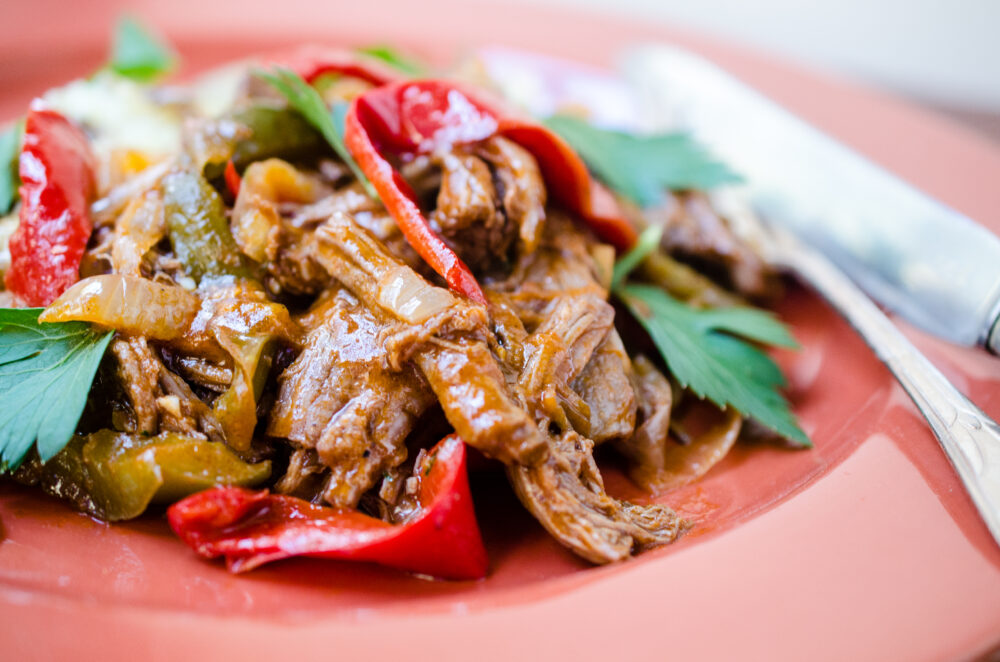 Braised Flank Steak with Peppers and Onions