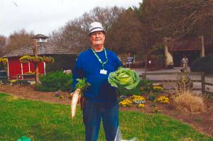 man holding large vegetables