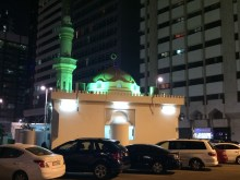 Tiny mosque in middle of city