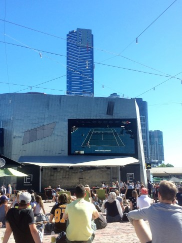 Watching a game at Federation Square