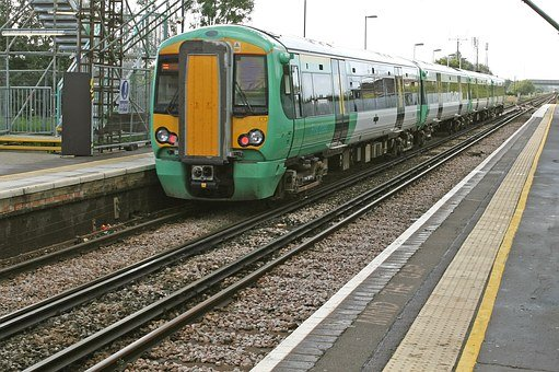 Train travelling on the tracks in the UK