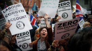 Jewish Labour Movement accuses Corbyn: LONDON, ENGLAND - APRIL 08:  Campaigners from the Campaign Against Antisemitism demonstrate and listen to speakers outside the Labour Party headquarters on April 8, 2018 in London, England. Protesters are calling on Labour's hierarchy to 'hold Jeremy Corbyn to account' after claims that he and the party are not doing enough to root out anti-Jewish hate in its membership.  (Photo by Christopher Furlong/Getty Images)