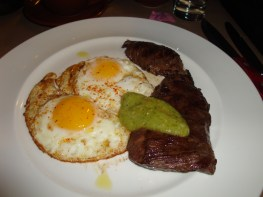 skirt steak with green sauce and fried eggs at the Breslin