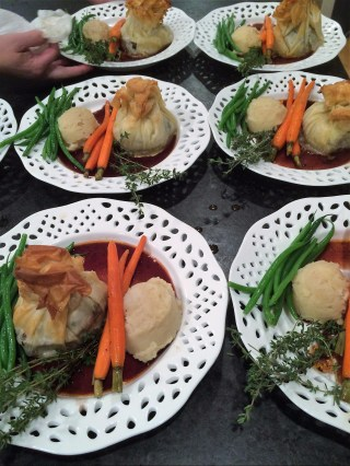 The entree is Beef Tenderloin Croustades in Phyllo, Red Wine Demiglace, Celery Root Mashed Potatoes, Ginger Glazed Carrots & Haricot Vert