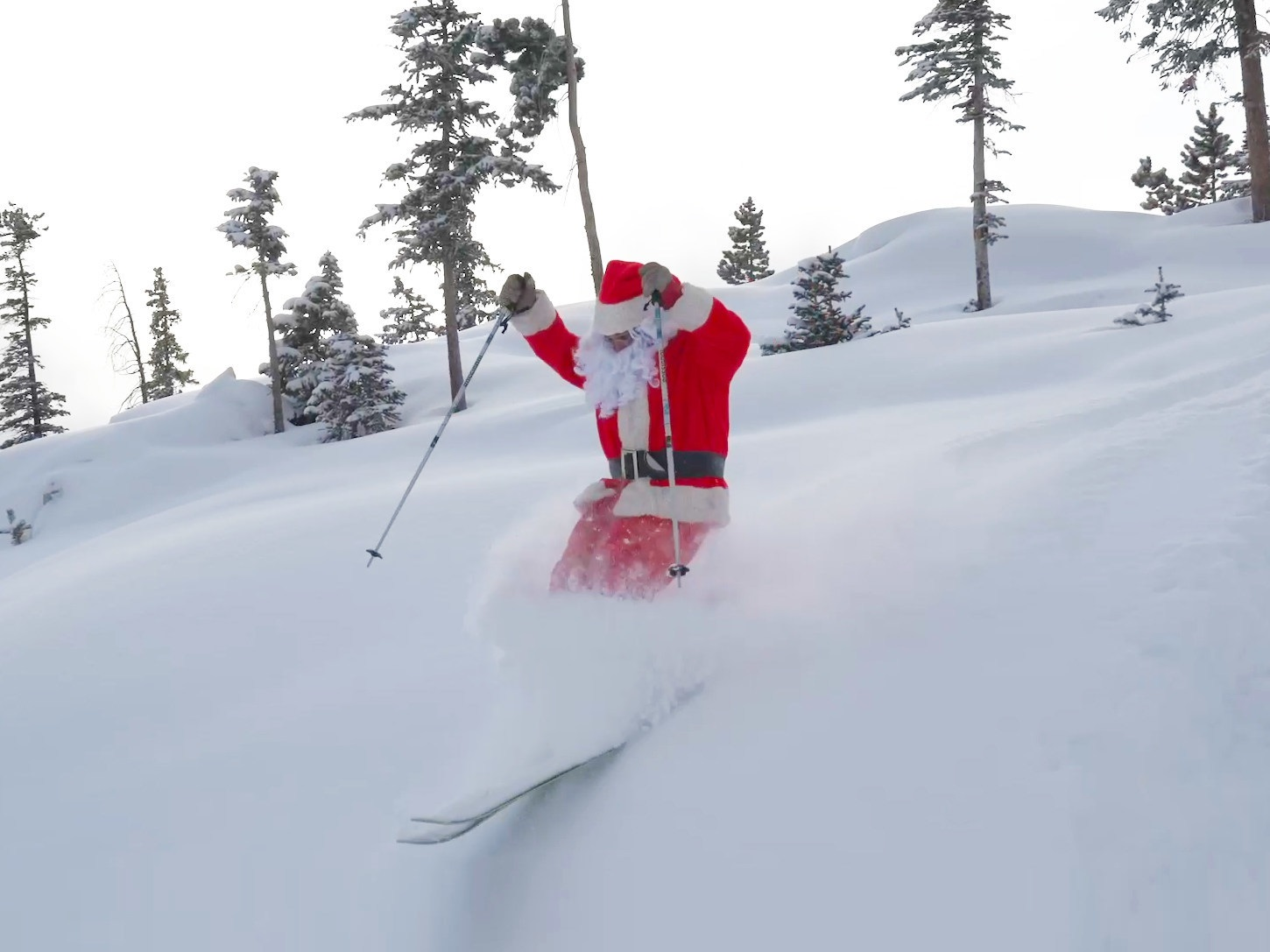 Santa takes a break from Christmas Eve preparations to venture out on the slopes of Winter Park Resort in Colorado.