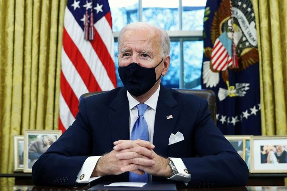 Biden's decision to immediately roll back Trump's travel ban won praise from business groups and migrant advocates.