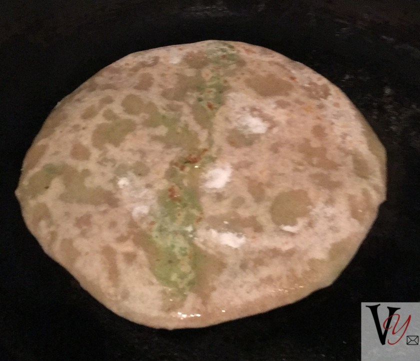cooking stuffed paratha