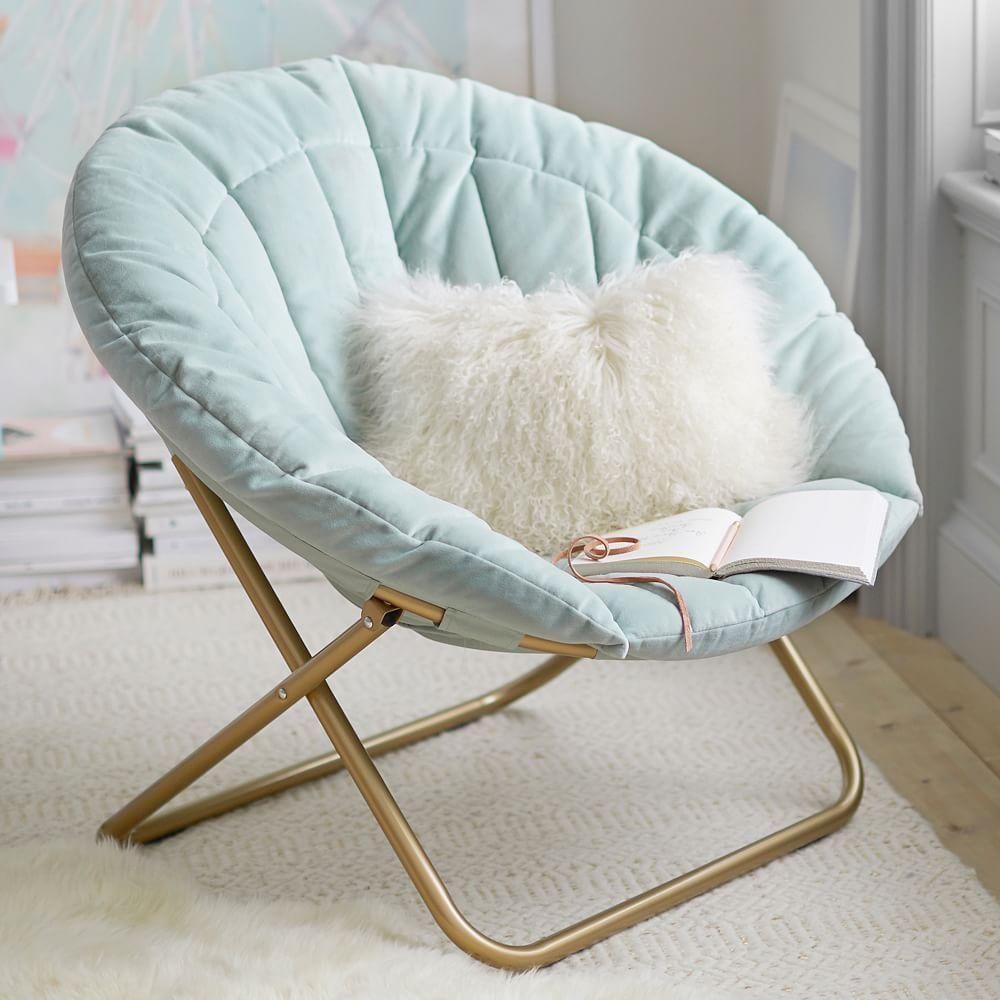 A round, teal, plush saucer chair