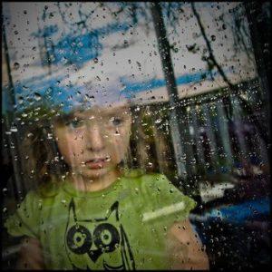 Child-Looking-Window-Rain-350-by-Todd-Baker