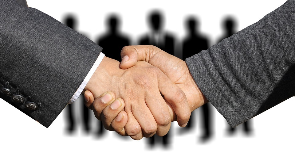 Shaking hands to represent building trust with your website viewers