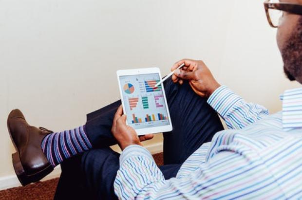 Man checking his digital marketing analytics for SEO results