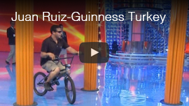 Video thumbnail shows World Access For The Blind Perceptual Navigation Instructor Juan Ruiz riding a bicycle in a TV studio as he breaks his own previous Guinness World Record for fastest bicycle slalom by a blind person on the Guinness TV program in Turkey. Click the thumbnail to see and hear the video on the Turkish website.