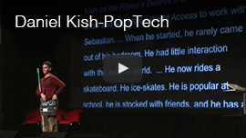 Video thumbnail shows Daniel Kish on-stage at the PopTech conference with a video projection of text showing behind him on a large screen. Click here to go to the video in a new window.