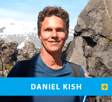 Link Box shows photo of Daniel Kish stanading between two rock formations in Iceland. Click on the box to go to Daniel's page.