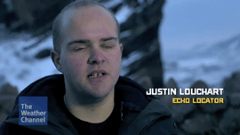 Video thumbnail screengrab shows Worldf Access For The Blind Perceptual Navigation Coach J Steele-Louchart with his cap off and the text Justin Louchart Echo locater superimpposed over the scene at twilight in a state park in Colorado.