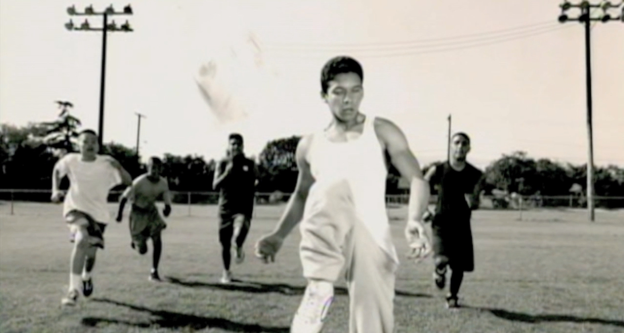 Photo banner shows a black and white lphoto of World Access For The Blind Perceptual Navigation Instructor Juan Ruiz playing soccer as a teen.