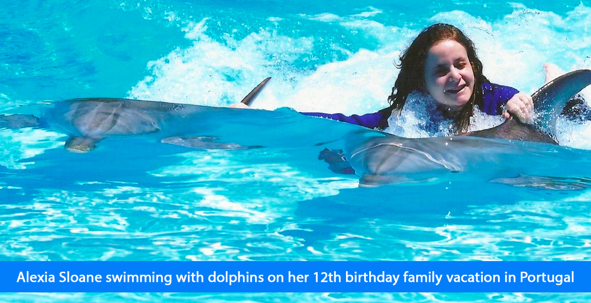 Alexia Sloane swims with dolphons on her 12th birthday family vacation in Portugal.