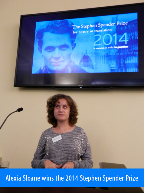 Alexia Sloane wins the 2014 SPender Prize. Image: ALexia accepts her prize at a podium under a video monitor showing an image of Prize's namesake with the text: The Stephen Spender Prize for poetry in translation 2014 in association with the Guardian.