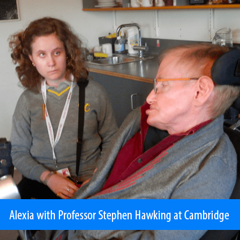 Alexia with Professor Stephen Hawking at Cambridge. Image shows Alexia sitting next to Professor Hawking in his office at Cambridge.