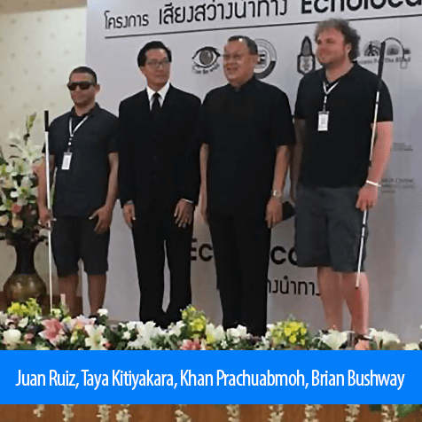 Juan Ruiz, Taya Kitiyakara, Khan Prachuabmoh, Brian Bushway. Image. Juan Ruiz and Brian Bushway stand with Project President Professor ML Taya Kitiyakara and Khan Prachuabmoh, Chairman of the Foundation For The Blind In Thailand under the Patronage of Her Majesty The Queen.