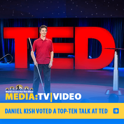 MEDIA: TV|VIDEO: DANIEL KISH VOTED A TOP-TEN TALK AT TED. Image: Daniel Kish, President of World Access For The Blind, stands onstage with the TED logo behind him.