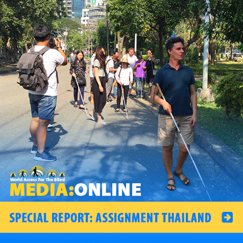 Media:Online. Special Report: Assignment Thailand. Image: WAFTB President Daniel Kish leads a group of blind student instructors along a road in Bangkok, Thailand.
