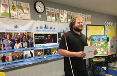 Visioneer Brian Bushway is pictured holding a reflective board as he stands at the front of a classroom in Los Angeles.