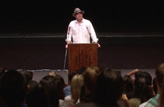 Visioneer Brian Bushway is pictured at a podium at Pepperdine University.
