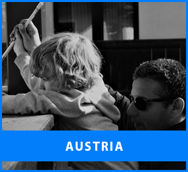 Austria. Image: Black and white photo of Senior Multicultural Visioneer Juan Ruiz working with a young blind student in Tyrol, Austria.