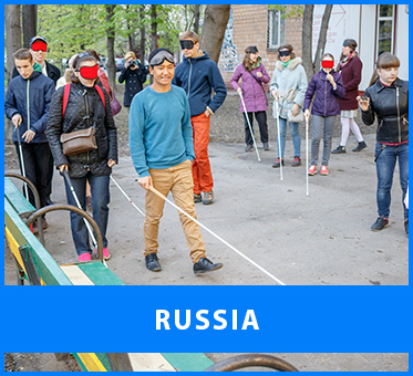Russia. Image: Workshop Visioneer Thomas Tajo leads blind and sighted participants in the outdoor portion of two workshops at the soundartist.ru Sound festival in Moscow.