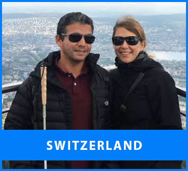 Switzerland. Image: Senior Multicultural Visioneer Juan Ruiz and his wife Nina pause for a scenic photo at an outlook in Zurich on the way to a training session.