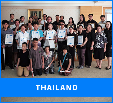 Thailand. Image: A group photo at the Foundation for the Blind in Thailand asVisioneers Daniel Kish, Brian Bushway and Thomas Tajo stand with staff members and blind trainee Visioneers coaches after they've received their Instructor Certificates of various ranks.