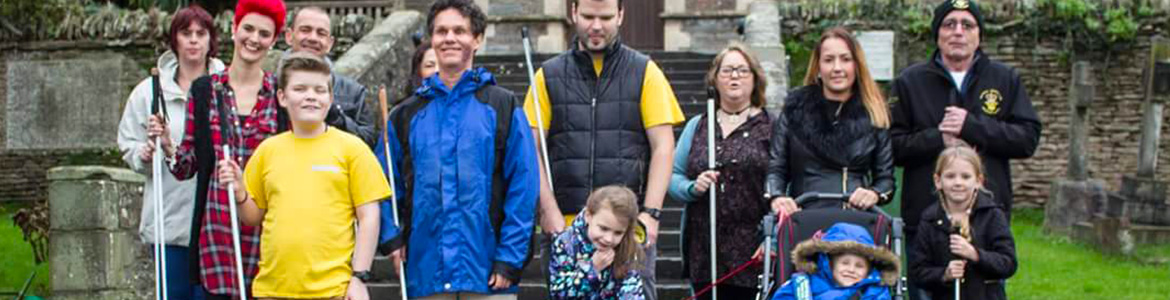 Image: Lead Visioneer Daniel Kish stands with a group of parents and blind students in Bristol, England, where he advocated on behalf of , then, 7 year-old Lily-Grace to be able to use her full-length Perception Cane at school.