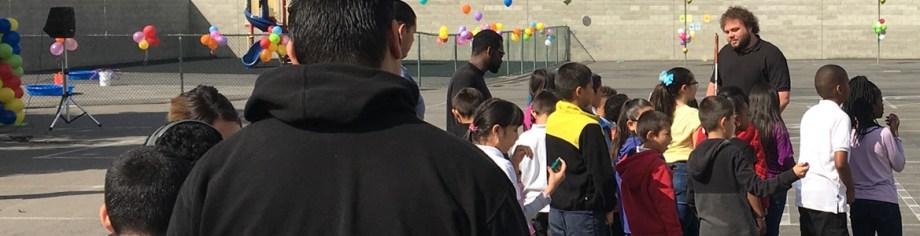 Image: Senior Visioneer Brian Bushway leads a workshop outdoors during an elementary school's Science Fair in Los Angeles.