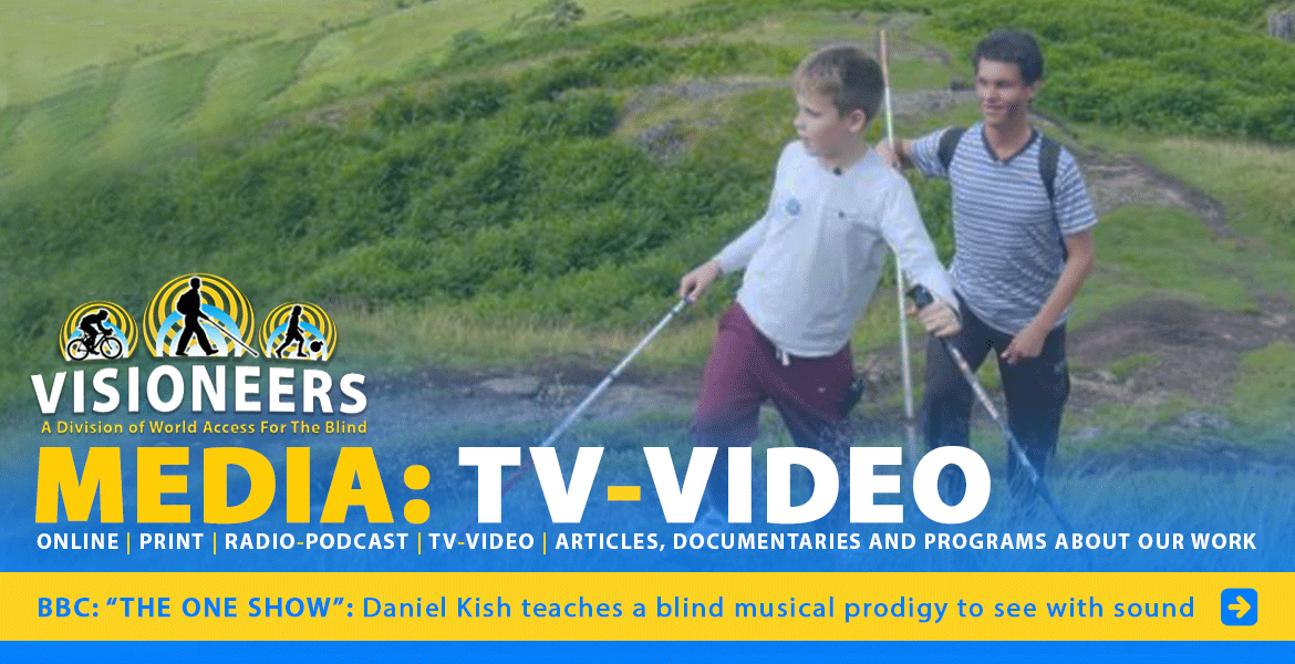 Visioneers: Media: TV-Video: BBC: The One Show: Daniel Kish teaches a blind musical prodigy to see with sound. Image: Lead Visioneer Daniel Kish walks behind student Visioneer Ethan David Loch as they climb a large hill in Scotland.