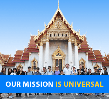 Our Mission Is Universal. Lead Visioneer Daniel Kish and Senior Visioneer Brian Bushway stand with blind Instructor Visioneer Trainees in front of a gilded temple in Thailand.