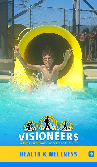 Category link: Health And Wellnesss. Visioneers' student Nava is pictured sliding out of the end of a water slide.