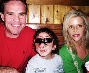 Photo of Humoody Smith with his adoptive parents Randy and Julie Smith in 2007.