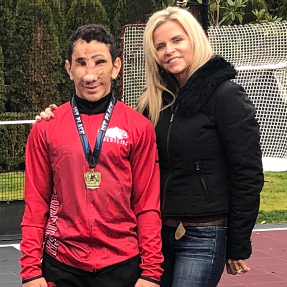 Image: Photo of Humoody Smith and his mother Julie Robinett Smith taken outside the Everett Wrestling Classic, December 15, 2018 In Everett, Washington. Humoody is wearing his gold medal for winning first place in his weight class.