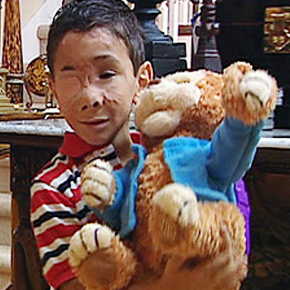 Image: Photo of young Humoody Smith holding a teddy bear.