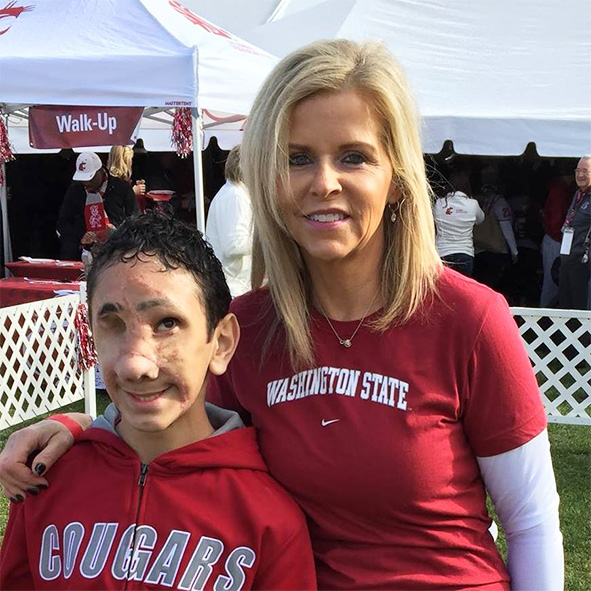 Image: Humoody Smith and his mother Julie wearing their team colors at a Washington State Cougars football game.
