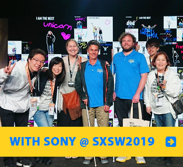Daniel Kish and Brian Bushway stand with the SONY Inclusive Design Team for a photo at South By SouthWest in Austin, Texas.