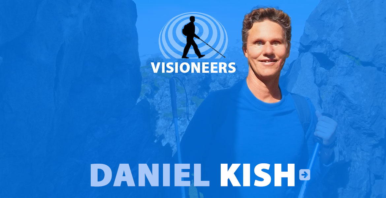 Daniel Kish. Photo of Daniel between a rock wall in Iceland.