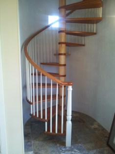 All wood Spiral stair with wood treads rail and balusters
