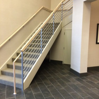 14 - Transitional Straight Box stair with Iron Horizontal Rails