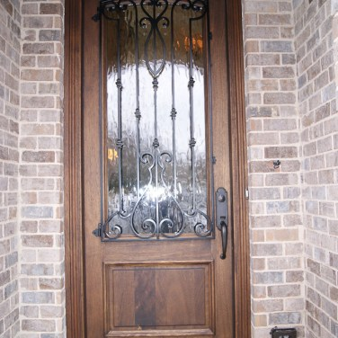 16 - Custom Mahogany Front Door with Iron and Glacier glass