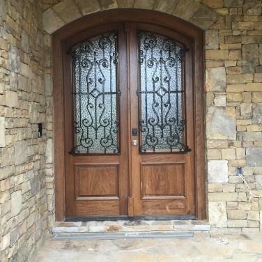 24 - Mahogany Double Door with Iron and Raised Panel