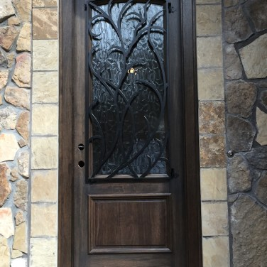 30 - Mahogany Single Door with Forged Iron and Ebony Stain