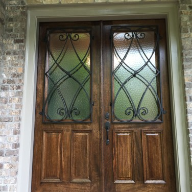 31 - Mahogany Double door with Custom Iron grills