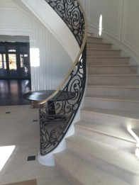 Modern Curve stair with Custom Forged Iron and Bronze rails
